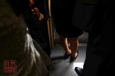 Woman feet in subway train, Tokyo