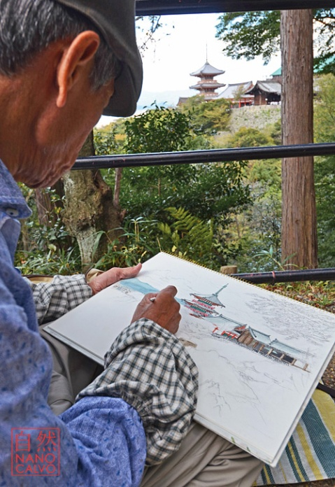 Talented street artist painting Kiyomizu-dera Temple, Kyoto